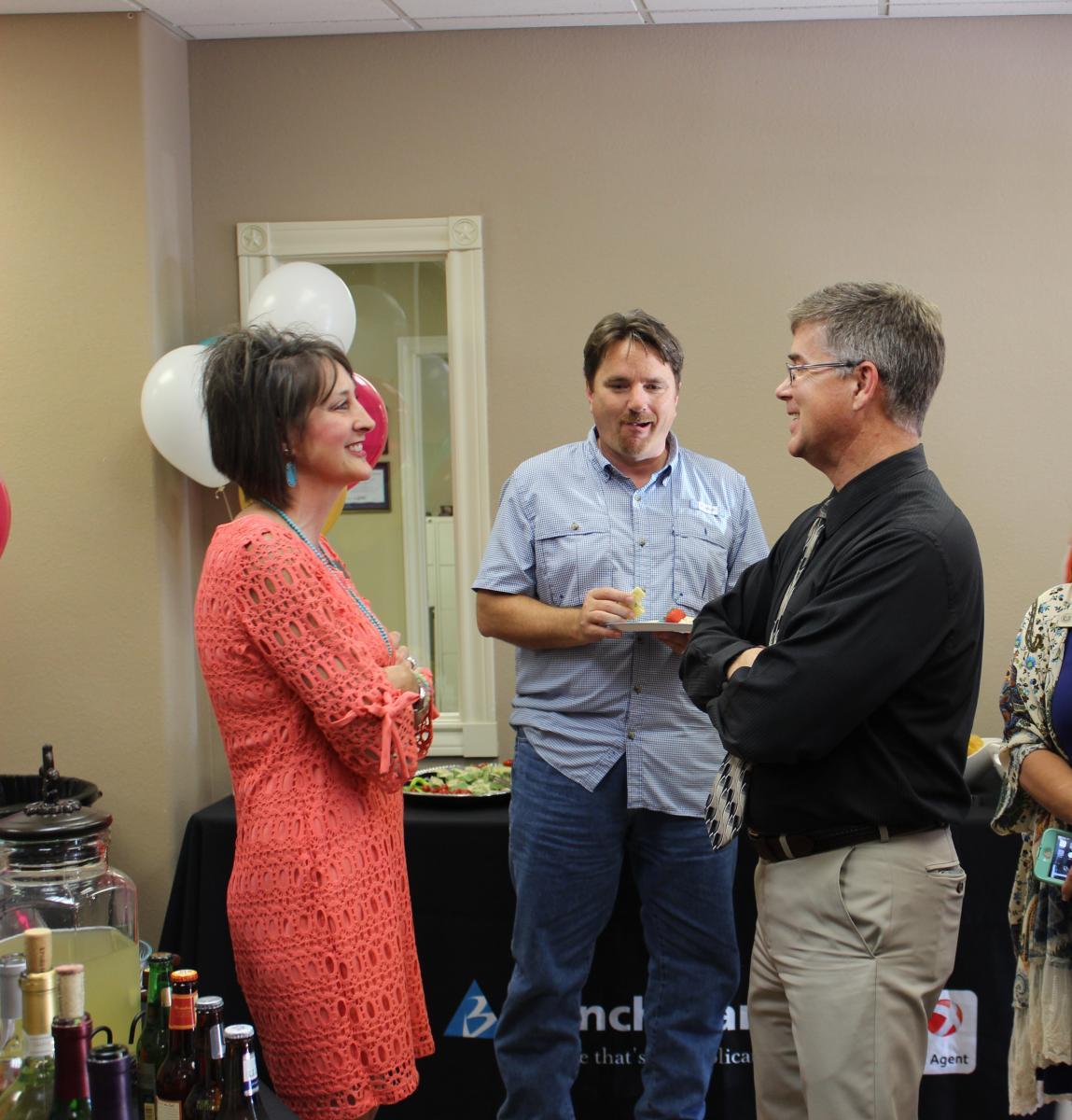 Lora Cheney and guests at Burnet Ribbon Cutting
